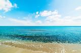 Blue sea and white clouds in Sardinia