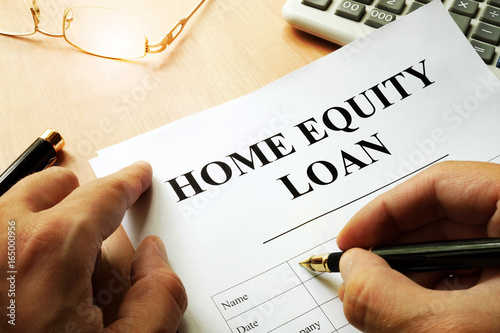 Document with name home equity loan on a desk.