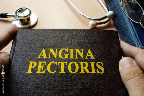Title Angina pectoris on a book which holding doctor