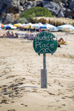 Nudist place wooden sign