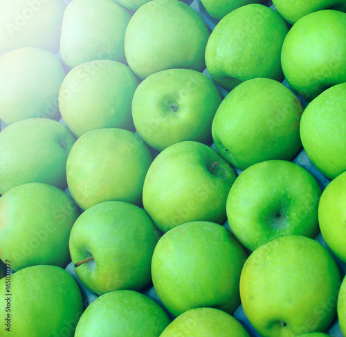 Green apples grown for sale, packed tightly - 165030377