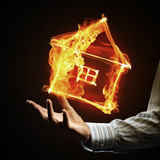 House fire icon in palm