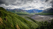 Panorama mountains and braided river in valley on an overcast day in Denali National Park, Alaska, United States