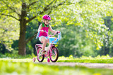 Child riding bike. Kid on bicycle. - 165055981