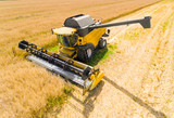 Aerial view of combine harvester. Harvest of rapeseed field. Industrial background on agricultural theme. Biofuel production from above. Agriculture and environment in European Union.  - 165082328