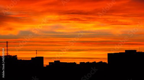 Poster Oranje eclat The urban sunrise