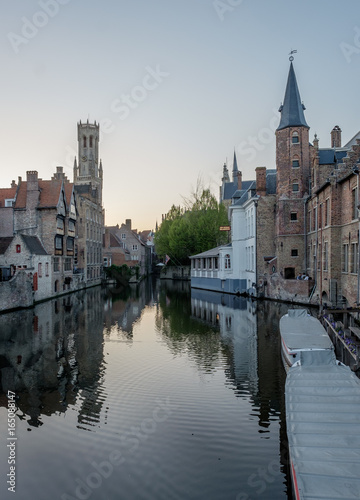 Historical building reflected in a canal in Bruges