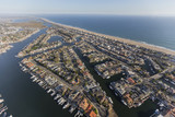 Aerial of Sunset Beach waterfront homes and boats in Orange County California.   - 165104337