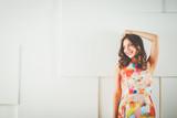 Beautiful female in sundress posing on white background. - 165130377