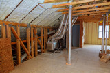 Foam plastic insulation installed in the sloping ceiling of new frame house. - 165134312