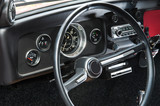 Interior of a retro car with the steering wheel