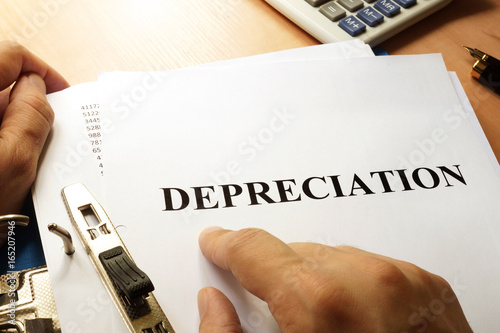 Stack of documents with name Depreciation.