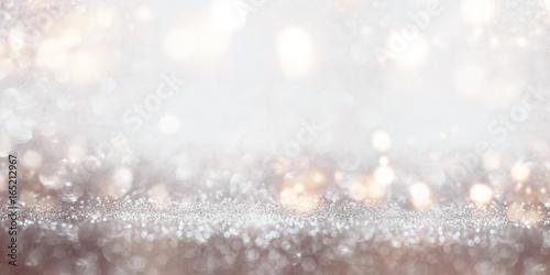 Świąteczny błyskotliwy srebny bokeh tło