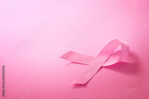 The Sweet pink ribbon shape on pink background paper for Breast Cancer Awareness symbol to promote in october month campaign