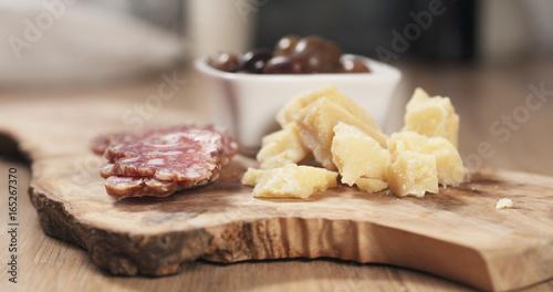 italian antipasti appetizers on olive board - 165267370