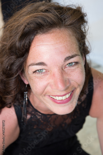 cheerful brunette woman smiling outdoor Poster