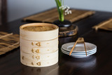 bamboo steamer set on the dinning table.