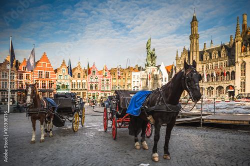 Fotobehang Brugge Horse carriages on Grote Markt square in medieval city Brugge at morning, Belgium.