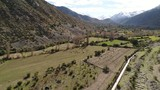 Aerial view of landscape, horses, farm, valley, mountains in Chile
