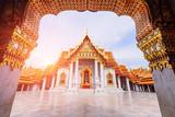 Wat Benchamabophit Dusitwanaram landmark in Bangkok with sunlight / Outside of Wat Benchamabophit Dusitwanaram
