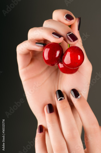 fashion manicure female hand with cherry