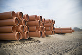 piled up pvc pipes - 165344703