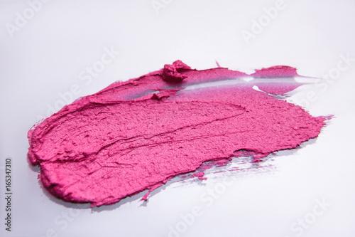 Lipstick pink stroke on white background. Fashion industry, beauty style, smear closeup. Creative advertising, glamorous magazine, cosmetics concept - 165347310
