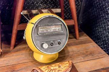 Half-sphere shape vintage radio in yellow