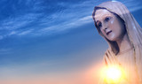 Statue of the Virgin Mary against sunrise - 165366761