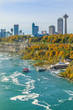 Canadian side of Niagara Falls with touristic boats