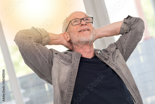 Relaxed man daydreaming, light effect