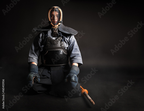 Kendo master sitting in traditional armor . Poster