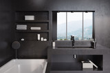 Black bathroom, tub, sink and mirror close up