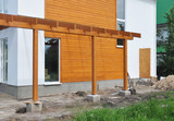 Contemporary Outdoor Terrace. Modern Home Construction with wooden pillars  terrace patio installation - 165416904