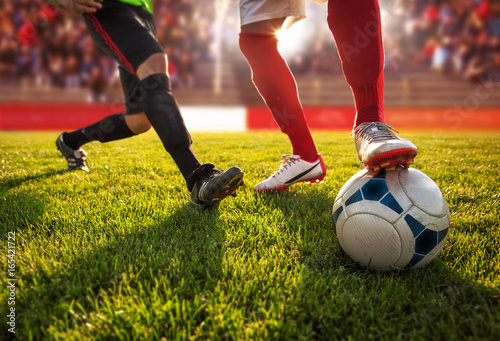 Fototapeta Soccer players in dribble position.Only legs are visible.