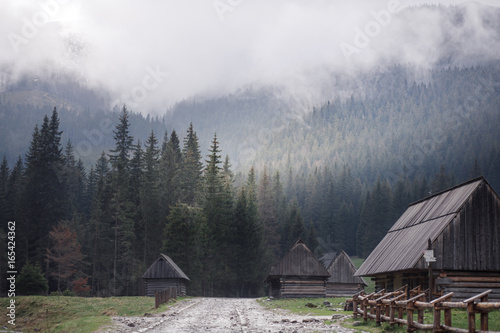 Wooden hut in the fog
