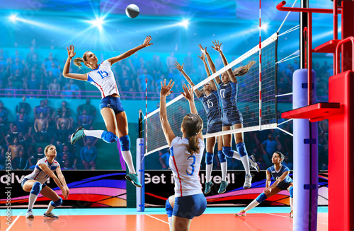 Fototapeta Female professional volleyball players in action on grand court