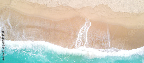 Aerial view of sandy beach and ocean with waves