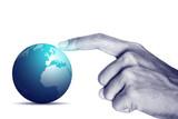Hand touching the world