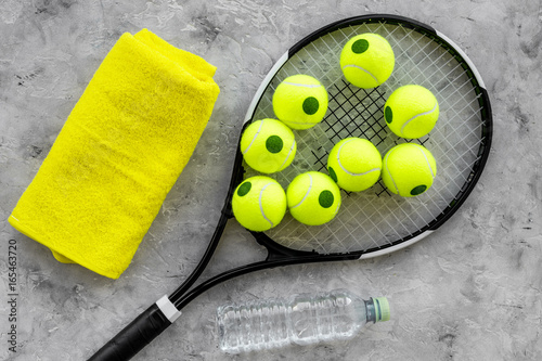 Sport mockup. Tennis balls and racket on grey background top view