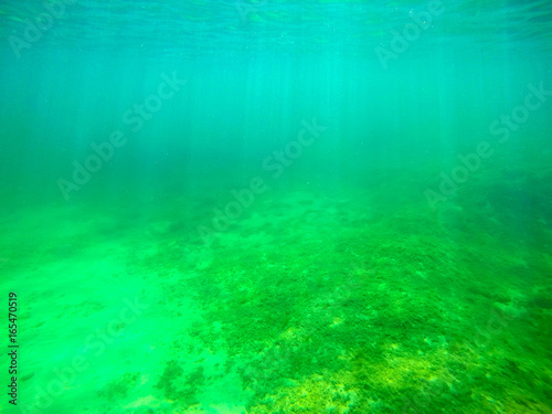 Foto op Canvas Groene koraal Sun rays seen from underwater