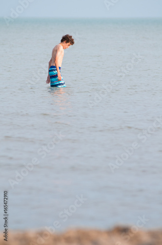 Poster Thirteen year old boy in the water of Lake Erie