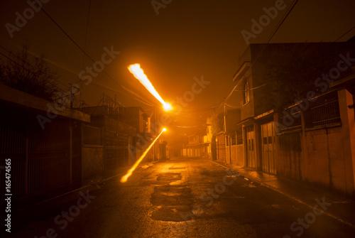 Foto op Aluminium Nacht snelweg Dark alley at night in Hanover, Guatemala.