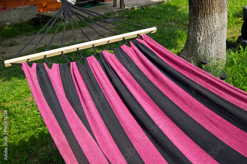 Aluminium Candy roze An empty hammock for relaxing in a rustic garden