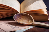 Wooden spoon and a vintage book - 165477767