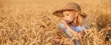 Happy child in autumn wheat field - 165484190