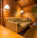 Cozy interior design of a rustic log cabin. - 165487148