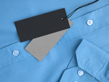 Two label price tags mock-up on blue shirt. - 165532533