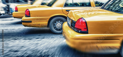 Yellow cabs in city avenue fast speeding, New York City