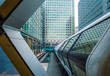 London, England - Public pedestrian cross rail footbridge at the financial district of Canary Wharf with skyscrapers - 165547391